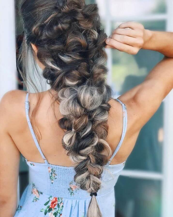 Dark brown hair with ash blonde highlights looks super chic, especially when braided like this