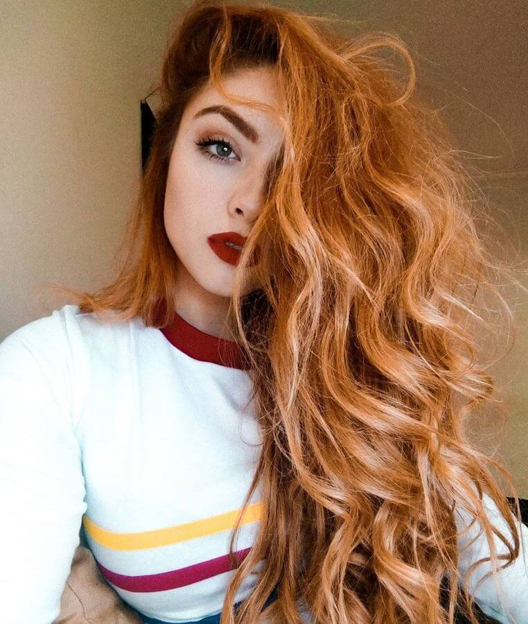 Fiery red hair looks divine with pale skin and red lips