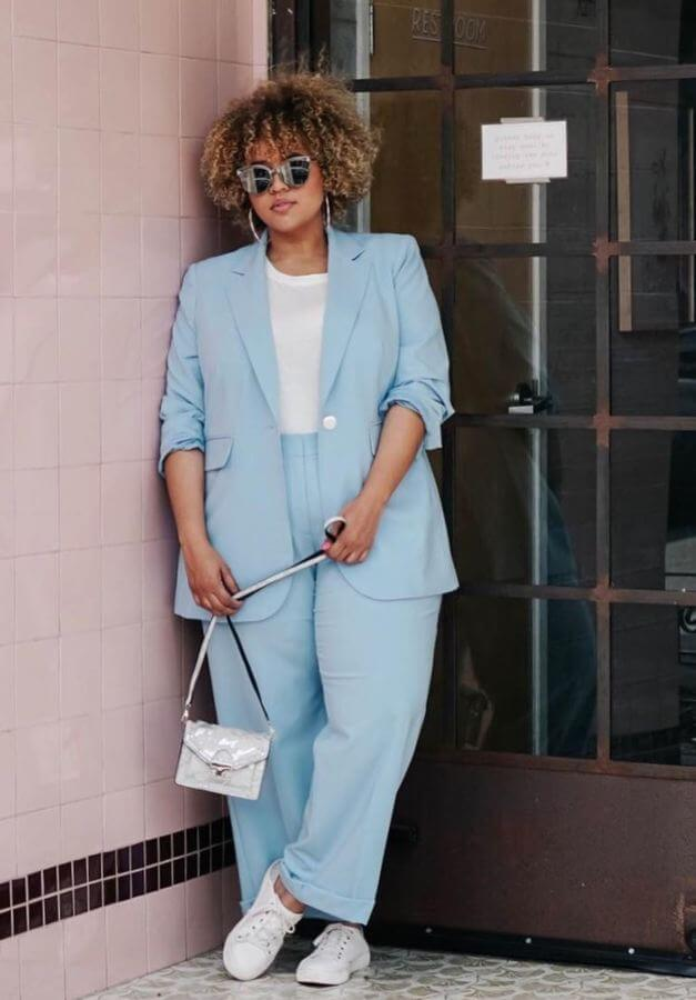 Give your suit a casual touch by pairing it with white sneakers. We love this powder blue number!