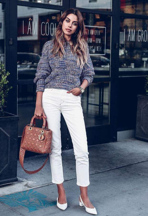 It's time to bring out your white jeans! We love this combination of white ankle jeans with a sweater top.