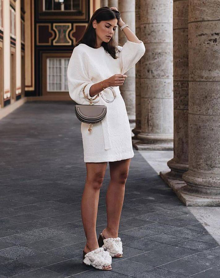 White dresses are a summer staple! Wear yours with fun shoes to look like a street style expert.