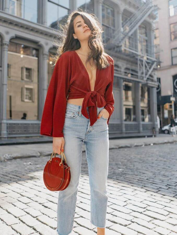 A flowy wrap-around top with voluminous sleeves captures the essence of summer beautifully. Add a unique handbag or clutch to really pull your look together.