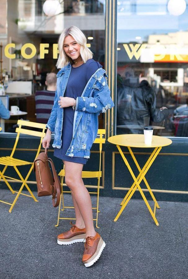 Pair an oversized denim jacket (this is where your boyfriend will come in handy) with a t-shirt dress and some chunky sneakers.