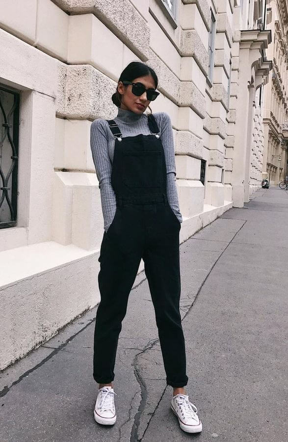 If you like monochromatic looks, try black dungarees with a grey sweater top.