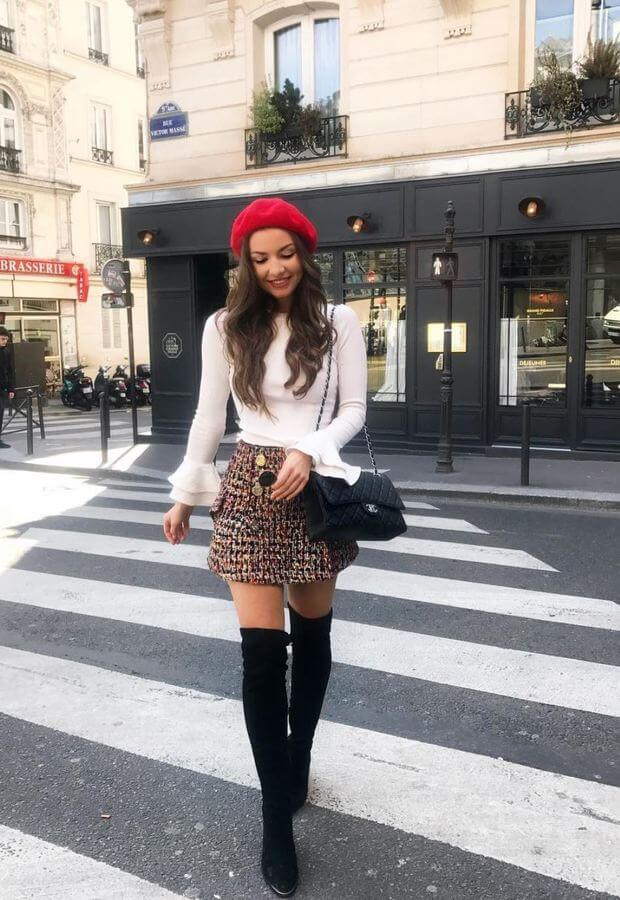 Since it's early summer, you can still wear a knitted skirt with a neutral top, and of course, knee-high boots are always a good idea!
