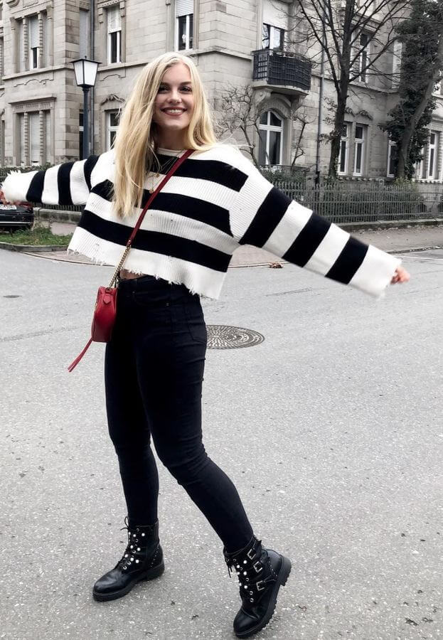 A boxy striped crop sweater with high-waisted jeans and boots is adorable and comfy!