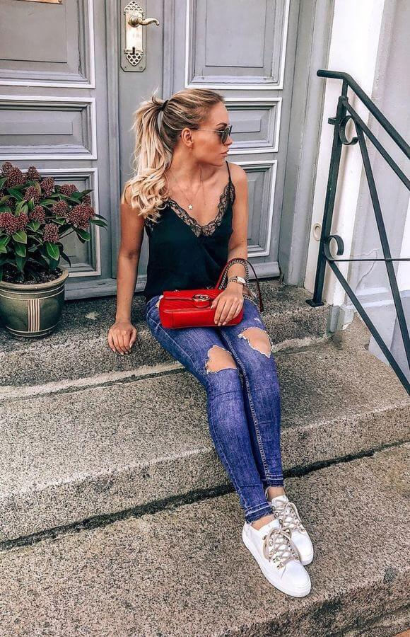 Keep it simple with a pretty cami top and distressed jeans.