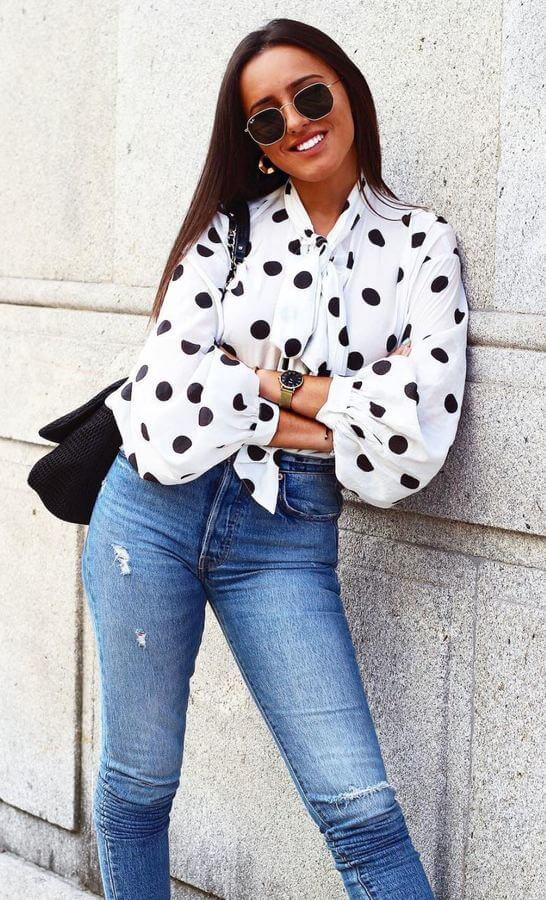 Looking for an easy go-to look? Simply throw on a pretty polka-dotted top with your trusty skinny jeans.