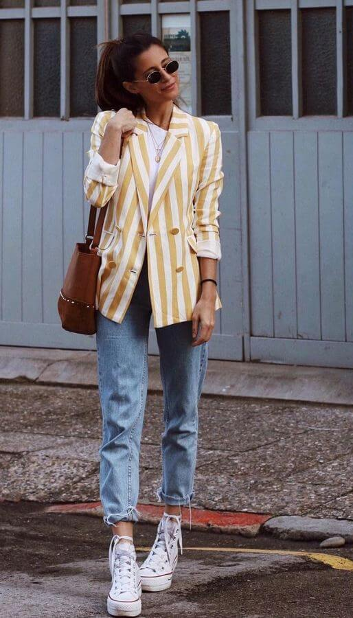 Boyfriend jeans always ooze a sense of effortlessness that cannot be compared! Pair yours with a fitted striped blazer to balance the look.