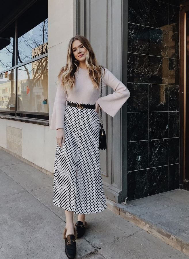 Midi skirts are all the rage this year! Pair your polka-dotted one with a nude top for a romantic look.