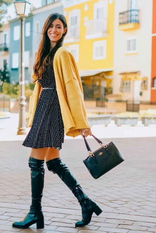 A polka-dotted dress with knee-high boots looks cute and well put together. If the weather is nippy, simply throw on a light sweater in a mustard yellow color.