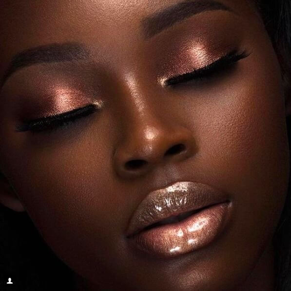 Metallics were not only trending in fashion, but they dominated in makeup world as well. You can apply a significant amount of bronze shine on your lips, and to highlight your eyes with metallic red-brownish shade.