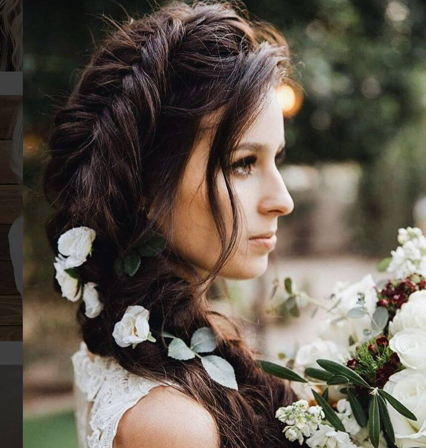 For a look right out of a romantic novel, try this fish braid with flowers on your hair. Leave out loose strands of your side-swept bangs to finish the look.