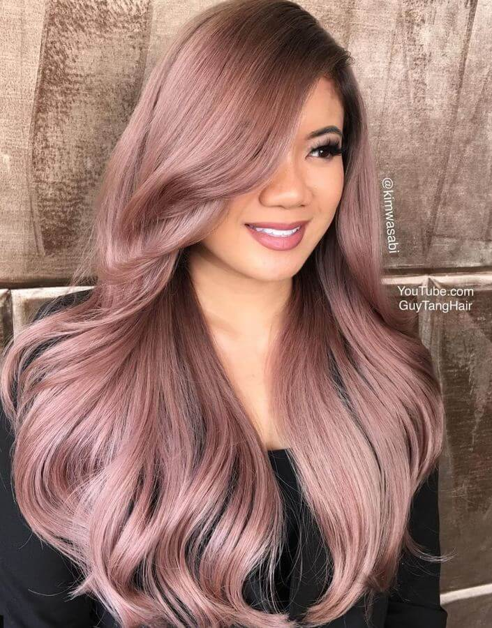 Healthy hair is happy hair, and this voluminous rose gold look with side-swept bangs is total #hairgoals!