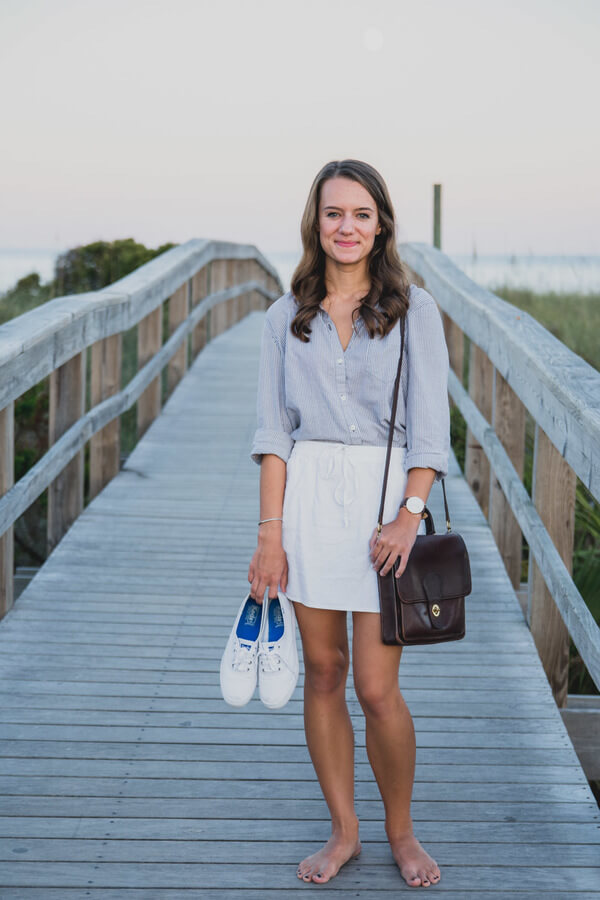 For a walk on the beach, a white mini skirt is for sure the way to go. To keep it casual but still preppy, add a button down light shirt. And some sneakers, yes, because they are trendy.