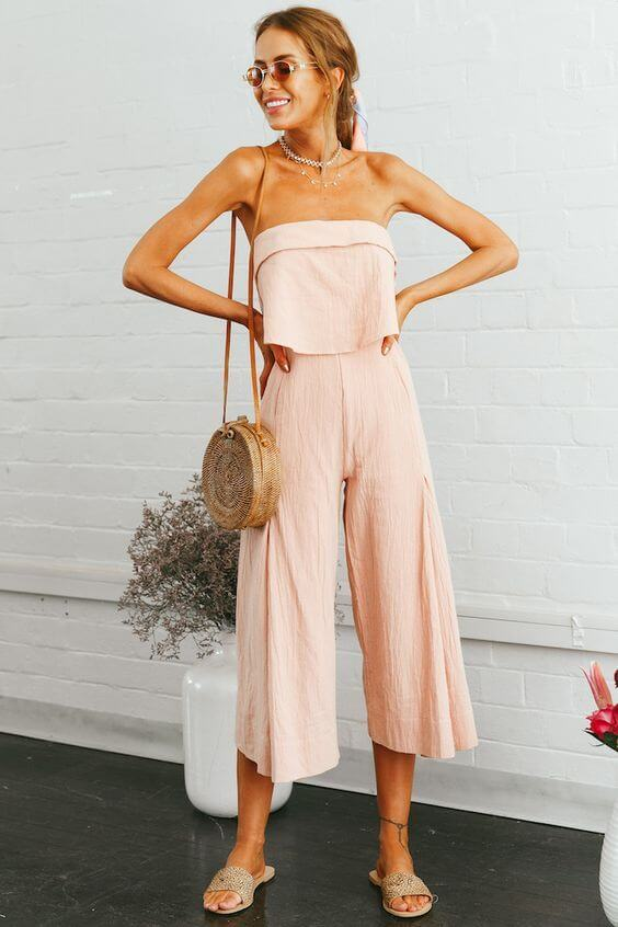 Jumpsuits are a very practical piece of clothing - you don't have to think about pairing or colors or patterns. Go with pastel pink jumpsuit for the trendy summer look. #summerstyle #summerfashion