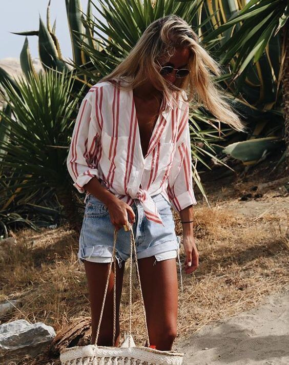 In the summertime, it is the best to wear your striped button-down knot. That way you can show off your figure, and it goes perfectly with denim shorts. #summerstyle #summerfashion