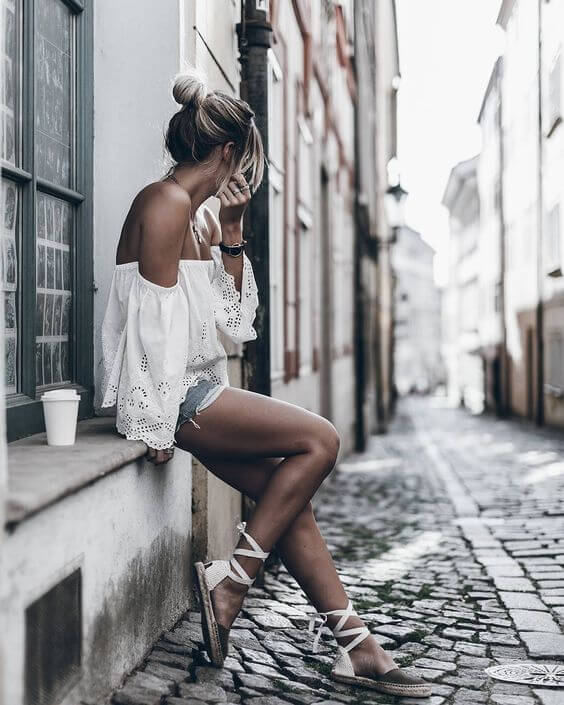 White off the shoulder lace blouse is paired with denim shorts and lace-up sandals for an amazing and comfy summer look. #summerstyle #summerfashion