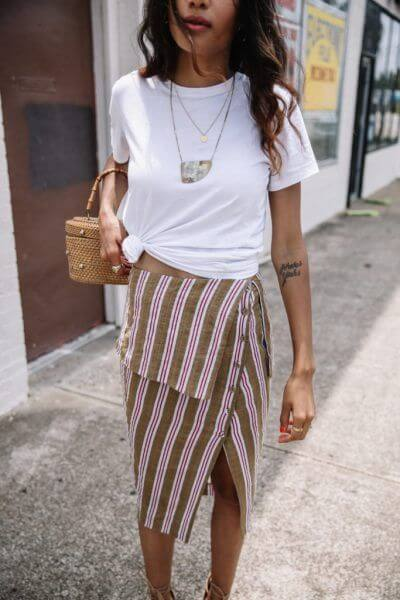 Asymmetric skirts are lovely cut items that you can wear anytime and for any occasion. Even with the simple white tee. #summerstyle #summerfashion