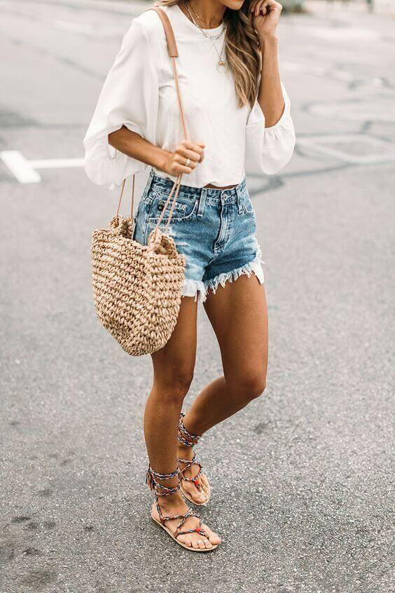 This casual look is perfect for summer season. Denim shorts might be our favorite item, while the white blouse and basket bag are working perfectly to create a leisure and chic combination. #summerstyle #summerfashion