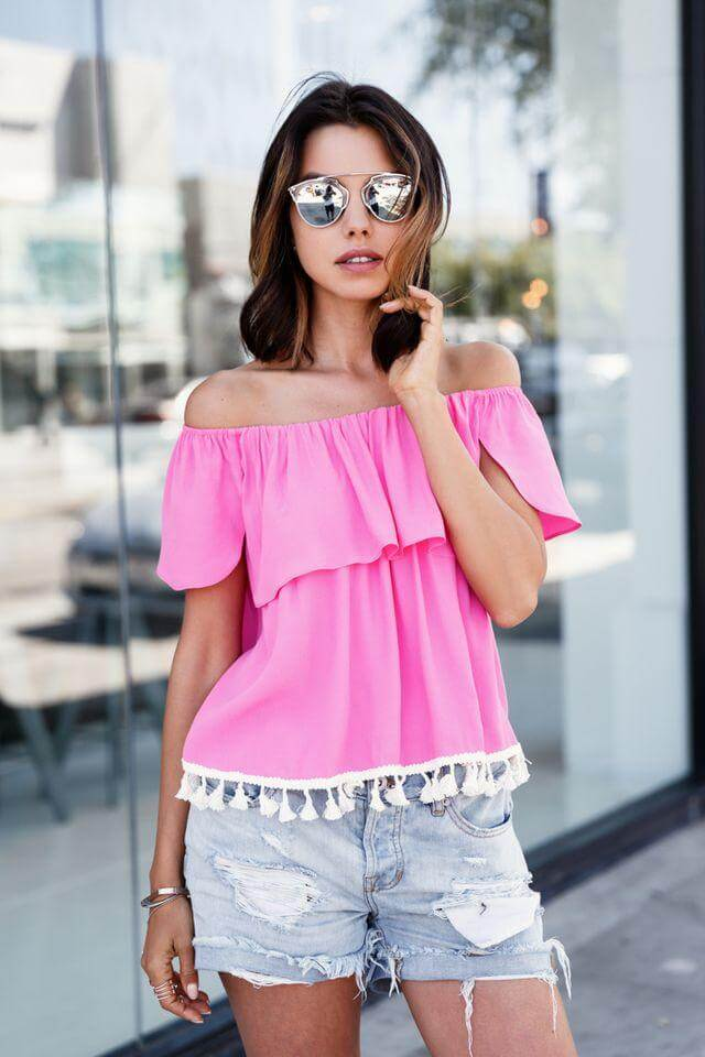 Pink top with white pom poms looks lovely when paired with denim shorts. Casual and stylish, right? #summerstyle #summerfashion