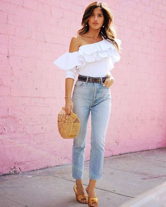 Stay chic even when the temperatures are really high. Wear one shoulder ruffle top in combination with jeans, studded belt, and gold satin mules. #summerstyle #summerfashion