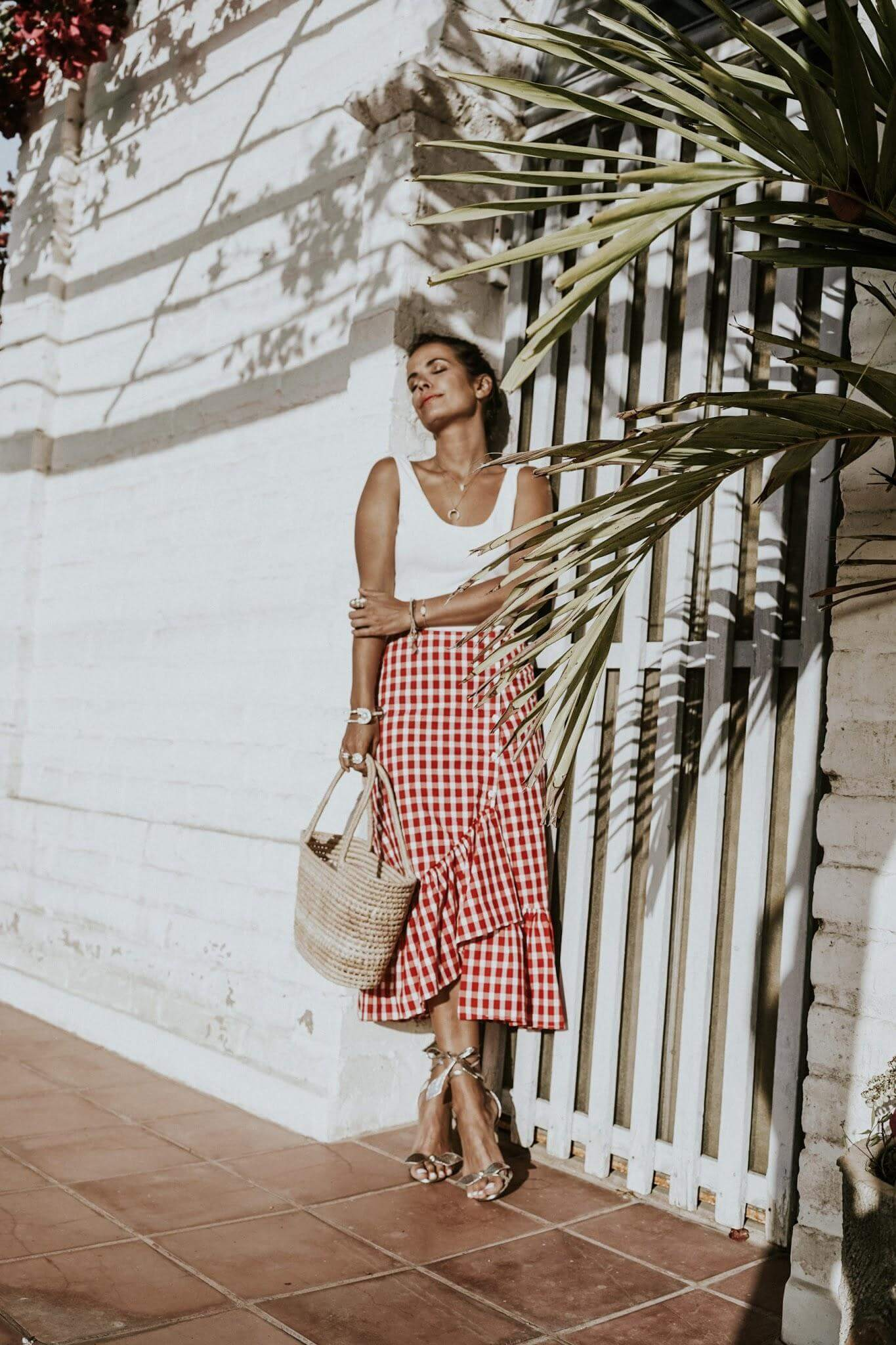 Wrap skirt with side ruffle in gingham print screams summer. Wear it with a simple white tank top and basket bag. #summerstyle #summerfashion