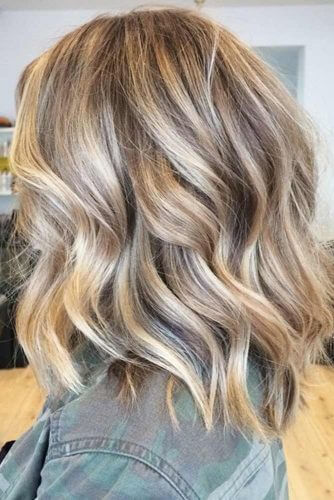 These gorgeous wavy locks show just how stunning a mix of blonde and brown can be!