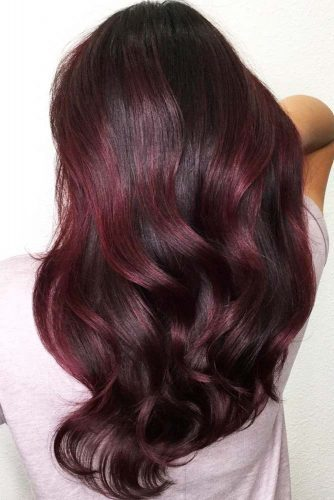 With a mix of deep black, ruby red, and a slight tint of purple, this look brings together a more sultry side of color!