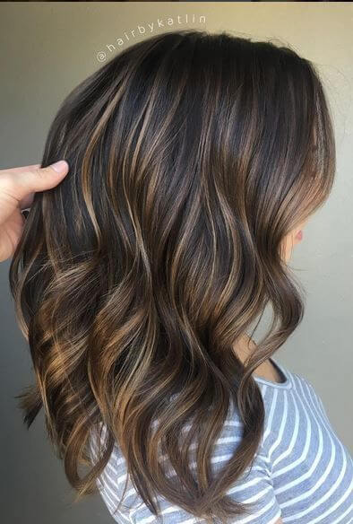 You can never go wrong with highlights! This color includes dark and light shades of brown, mixed with subtle hints of blonde strands.