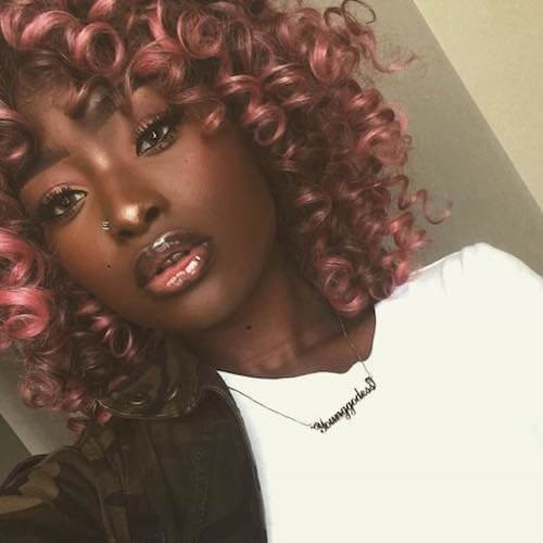 These luscious curls have an adorable pink bubblegum base that is complemented with some dark brown strands to finish off the look.