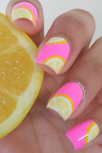 Nothing says summer like a tropical lemon wedge design! This detailed masterpiece is painted over a bright pink base and sealed with a shiny top coat.