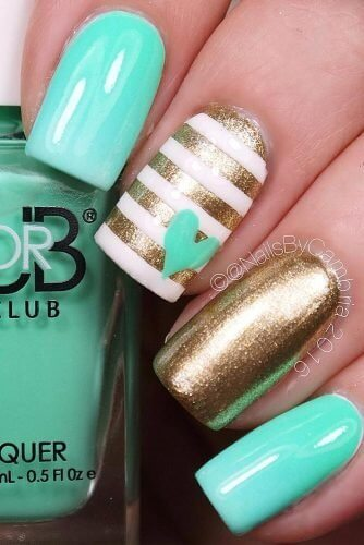 This baby blue and gold look is a fun design to try out, as its heart accent really makes manicure pop!