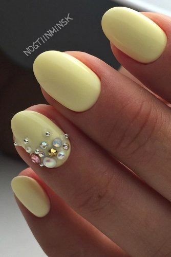 It's important to have some fun when painting your nails, which is exactly what this baby yellow and chunky jewel manicure promotes!