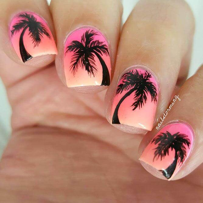 Putting a spin on the typical palm tree design, this silhouette nail art perfectly complements its pink ombre background.