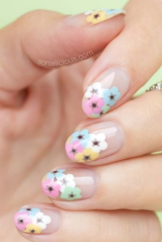 Painted over a clear nail, these pastel flowers make for an adorable manicure, perfect for any season of the year.