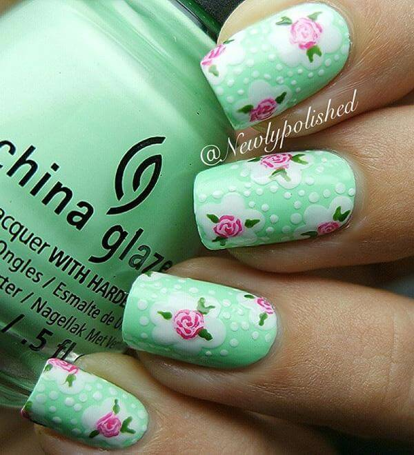 A more detailed nail art design, these stunning roses use different shades and colors with a small nail detail brush; it works perfectly over a cute mint green base.
