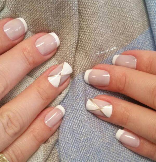 This elegant French manicure is accented with a geometric-inspired design; the simplicity and nude shade works well for any season of the year.