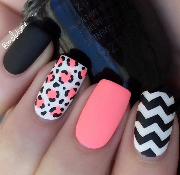 This matte manicure contains a mixture of pinks, blacks, and gorgeous leopard print details; the black and white chevron pattern tops off a stunning look.