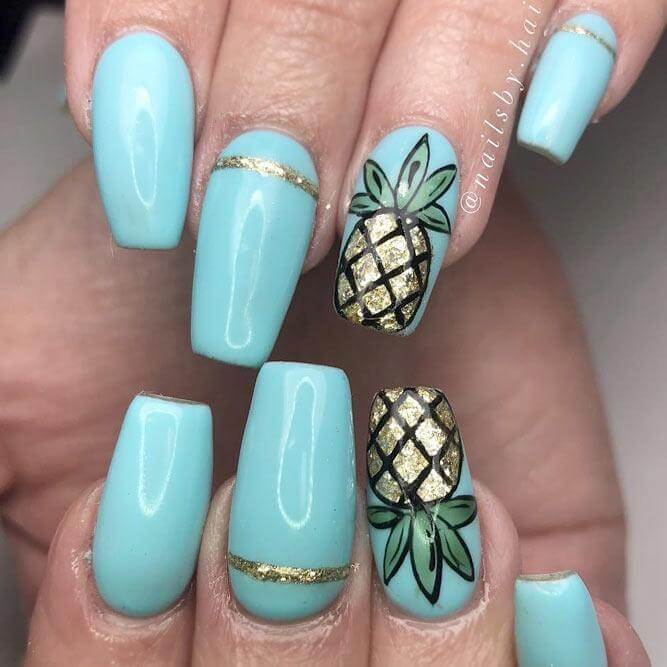 These detailed pineapple designs look gorgeous on top of a baby blue base coat; perfect for an elegant summer design.