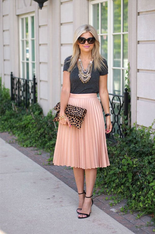 An A-line soft-pink skirt is a must for any girly girl out there. But, to add some edge, pair it with a tee and some animal print something- clutch, shoes.