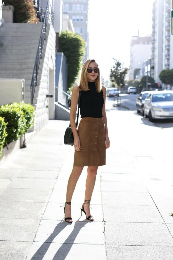 If you feel like you need a little bit of texture and a Texas touch, a suede leather skirt and a black tank top is the way.