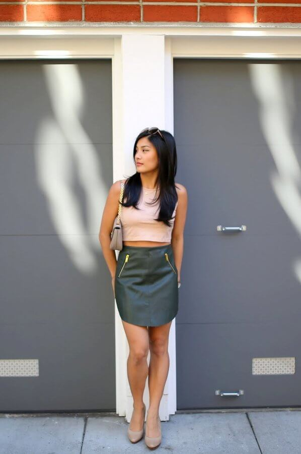Black leather can give off a rough feel to the look, so instead, you can get a green A-line mini skirt. To make the outfit day appropriate, match it with a nude top and nude heels.