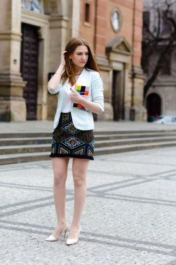 Tribal prints are making a comeback, and it's time to get on that trends. Pair your mini skirt with nude heels and all white on the top. For an office look, throw in a blazer, and you are ready to go.