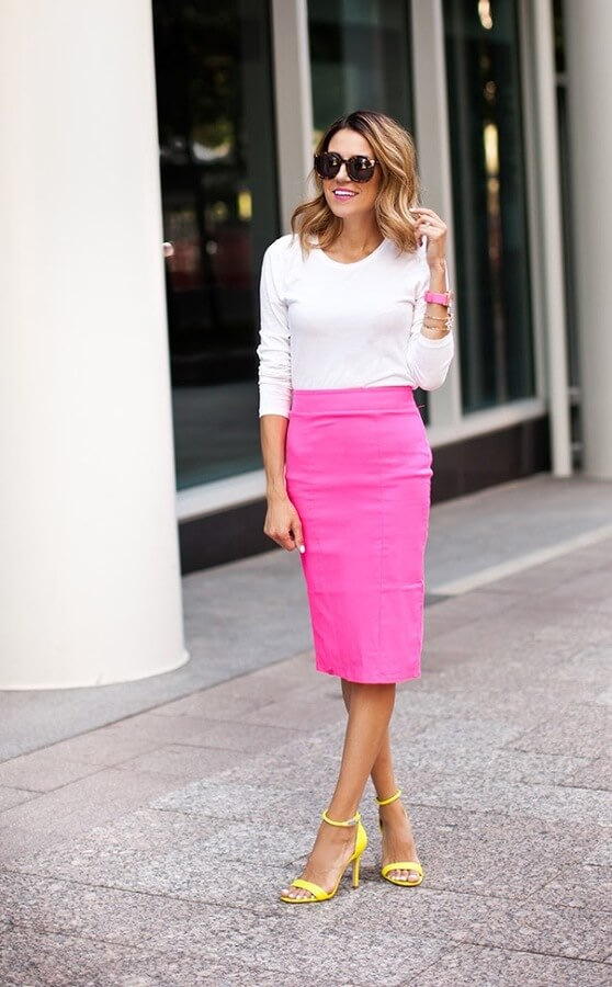 Color blocking has been around for some while, and it will for sure capture all the attention in a look. But, if you don't feel comfortable with having on two bold colors, bet it all on the accessories. So a bright pink skirt and a pair of yellow neon sandals.