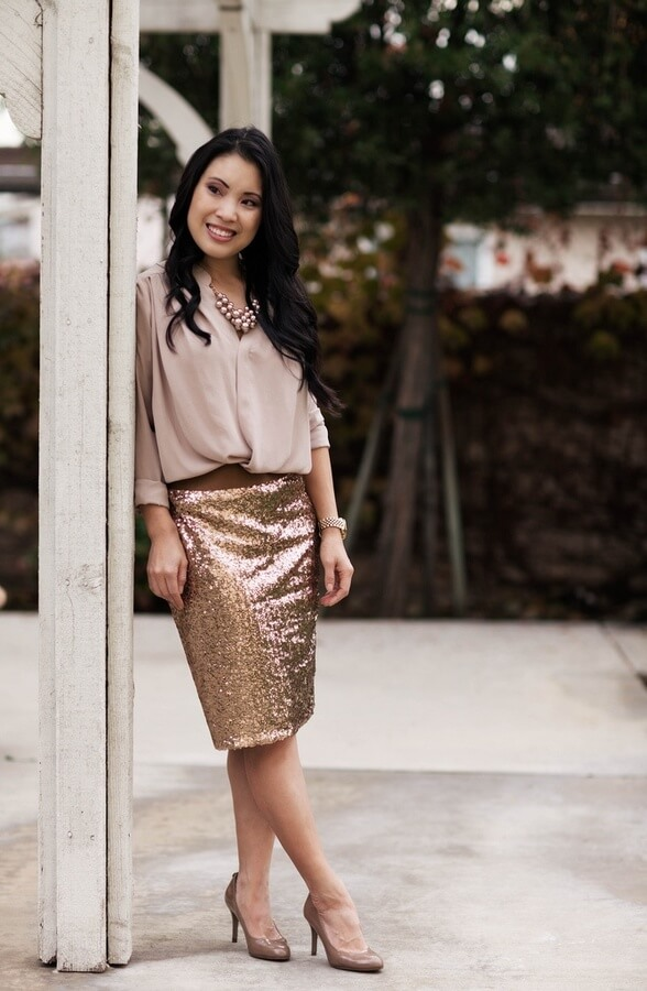 If you want all attention in the room, the one item that will help you get it is a gold sequin skirt. Add a silk button-down shirt and a pair of nude heels for a French-inspired outfit.