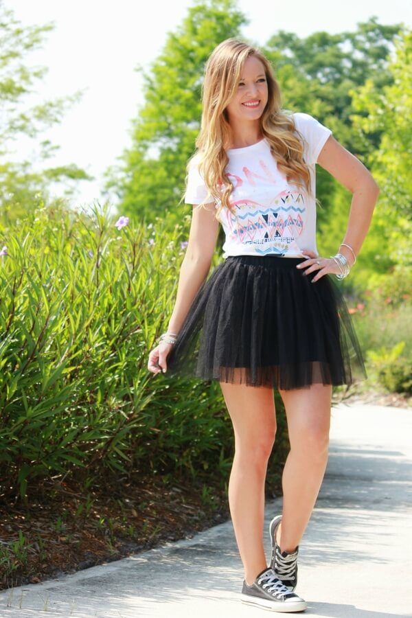 For a playful outfit, you need a mini tulle skirt. Remember when you wore those in your childhood? Do the same now, add a graphic tee and a pair of converse and the high school days are back.