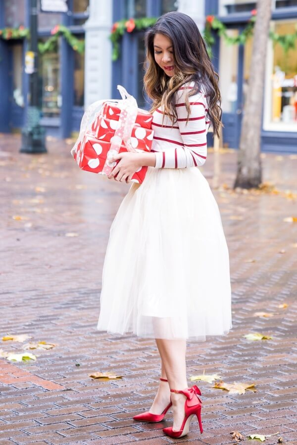 More is more. If you want to achieve that French old Parisian glam - go big or go home. A white mini tulle skirt and red will be perfect for a special occasion.