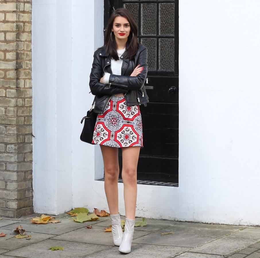 The best way to deal with the cold summer nights is a leather jacket and a pair of booties. Keep in mind that if your skirt has a bold print, keep it simple in rest.