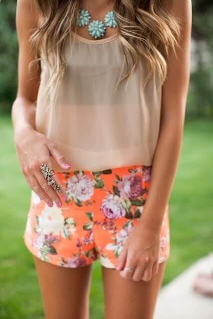 Orange shades seem very appropriate for hot weather season. Floral shorts and matchy orange sheer top are perfect for summer parties in the backyards or by the pool. #sheertop #summeroutfit